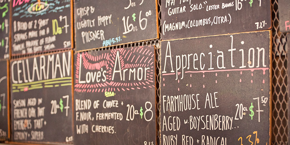 Several of the colorful chalkboards displaying our constantly rotating list of craft beer