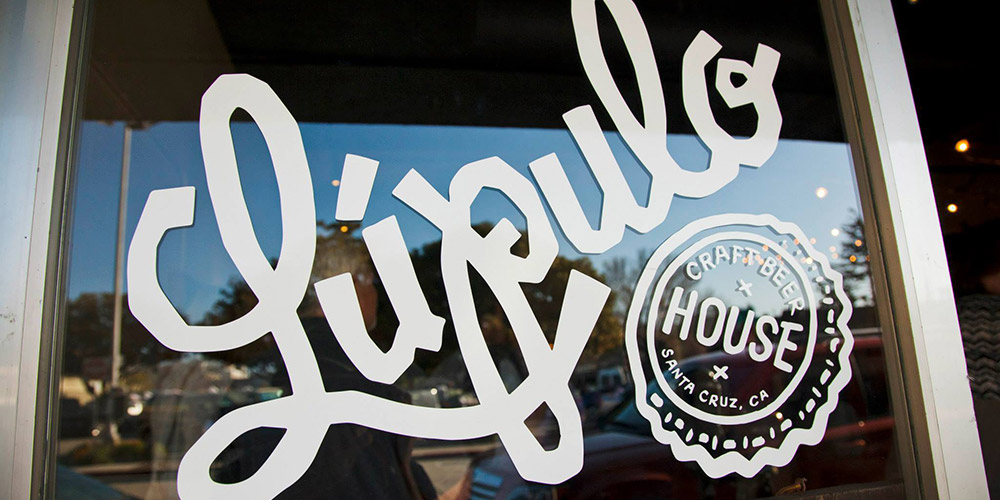 The Lupulo logo displayed proudly on the front window of our craft beer house in Santa Cruz, CA