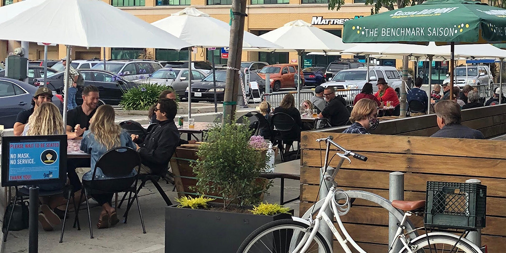 Lupulo is now open for patio dining or takeout - just ask these customers enjoying the sun on Lupulo's outdoor patio